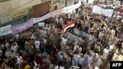 An image grab taken from a video uploaded on YouTube on October 7 shows people demonstrating in the central city of Hama.