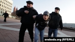 Police arrest a youth activist after he and two others pelted a Lenin statue with eggs in Minsk.