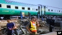 The engine of the Akbar Express appeared to be destroyed and at least three carriages were derailed in the collision.