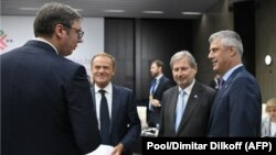 Serbian President Aleksander Vucic (left) speaks with Kosovar President Hashim Thaci (right) next to European Commissioner for European Neighborhood Policy Johannes Hahn (2nd right) and European Council President Donald Tusk during the EU-Western Balkans summit last month.