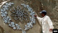A worker in Islamabad cleans a bas-relief of the Chaghi Mountains, where Pakistan conducted its atomic explosions in 1998.