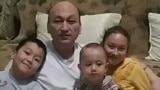 CHINA -- Omurbek Eli with his children in Kazakhstan following his release from detention in China, 2017.