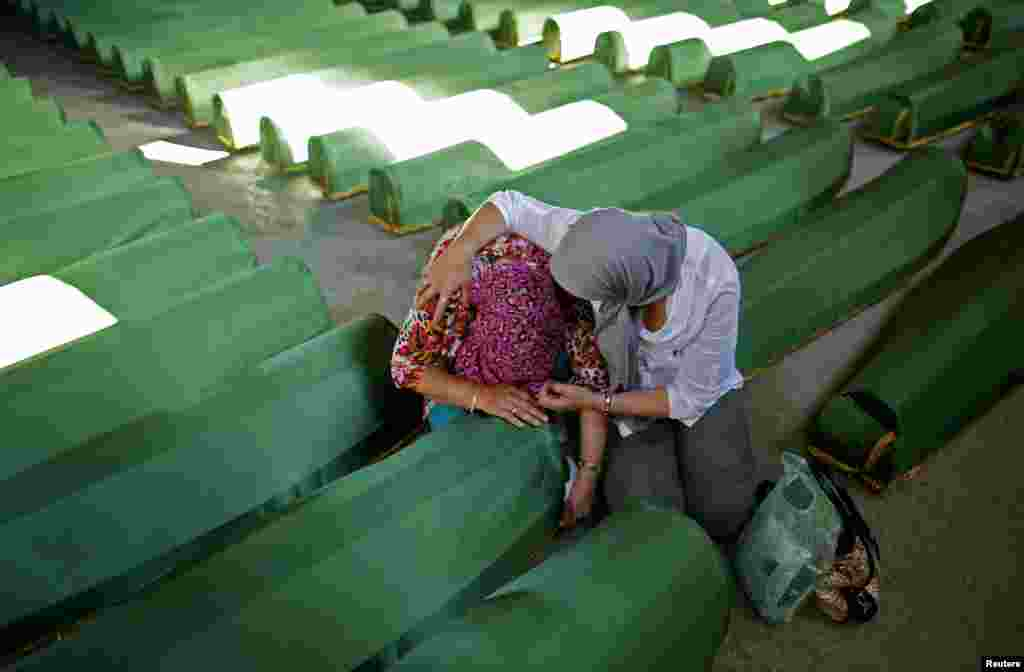 Bosnian women cry near one of the 173 coffins of newly identified victims from the 1995 Srebrenica massacre, in the Potocari Memorial Center, near Srebrenica, Bosnia-Herzegovina, ahead of the 19th anniversary of the massacre. (Reuters/Dado Ruvic)