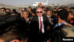 Afghan Vice President Abdul Rashid Dostum arrives at the airport in Kabul in July.