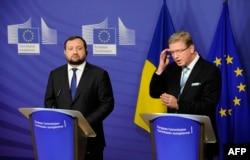 Сергей Арбузов и Штефан Фюле после переговоров в Брюсселе