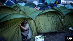 Греция-Македония чегарасидаги қочқинлар лагери.
