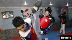 Nekpa (right) has complained about poor training conditions for taekwondo competitors in Afghanistan.