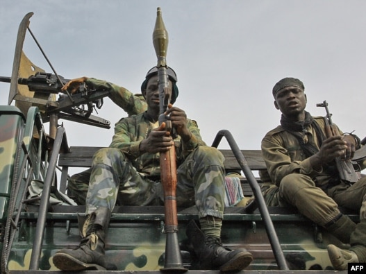 Pro-Ouattara fighters prepare for the so-called 'final assault' in Abidjan today.