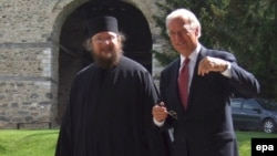 U.S. Vice President Joe Biden (right) talks with father Sava Janjic at the Visoki Decani monastery in May 2009.