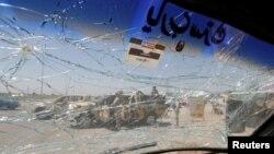Ираксткий военный автомобиль, задетый взрывом продуктовом рынке Эр-Рашидия во вторник