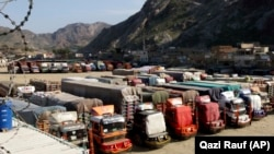 FILE: Trucks parked near the Pakistan Afghanistan border crossing in Torkham.