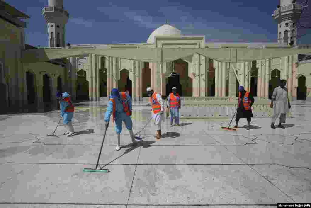Volunteers disinfect a mosque ahead of the Muslim fasting month of Ramadan in Peshawar, Pakistan, on April 24.