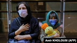 Iranians wearing masks spent the night in the streets after an earthquake hit near the capital Tehran on May 8, 2020