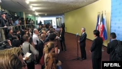 "Diplomats meet the press at the old ""stakeout"" site outside the UN Security Council chambers."