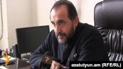 Armenia - Archbishop Mikael Ajapahian speaks to RFE/RL in Gyumri, 26Jan2015.
