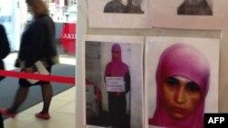 Плакат с фотографией предполагаемой смертницы