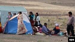 Палаточный лагерь для пострадавших от землетрясений в провинции Восточный Азербайджан. Иран, 13 августа 2012 года.