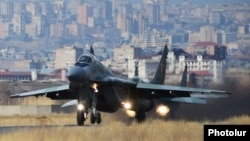 Armenia - A Russian MiG-29 fighter jet takes off from the Erebuni airbase in Yerevan, 14Mar2014.