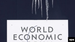 Switzerland -- Icicles hang over the World Economic Forum's logo in Davos, 26Jan2009