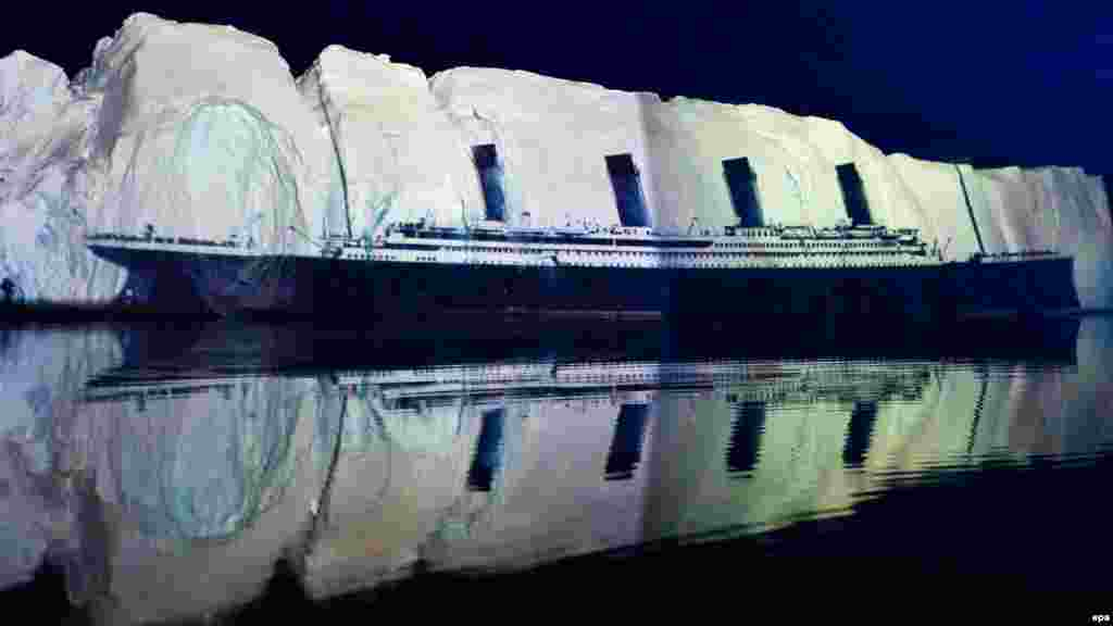 "An image of the ""Titanic"" is projected on a 500-meter-long iceberg off the coast of Greenland on April 13, 2012, in a tribute to the disaster by Swiss light artist Gerry Hofstetter."