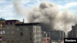 Smoke rises a building after the explosion in Diyarbakir.