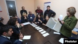 Armenia - Members of a precinct election commission in Yerevan count ballots cast in parliamentary elections, 2Apr2017.