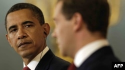 Presidents Barack Obama (left) and Dmitry Medvedev at the Kremlin on July 6