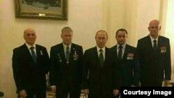 Владимир Путин с предполагаемыми руководителями ЧВК «Вагнер»