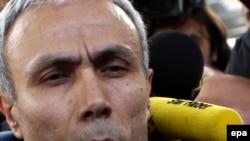 Стрелявший в Папу Иоанна Павла II Мехмет Али Агджа на выходе из тюрьмы (18 января 2010 года).