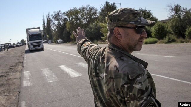 An activist stops a lorry near the village of Chongar, in the Kherson region adjacent to Crimea.