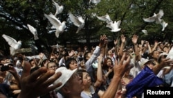 Japan -- People release doves as a symbol of peace at the Yasukuni Shrine for the war dead in Tokyo, 15Aug2011