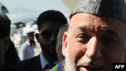 Afghan President Hamid Karzai upon his arrival at the Chaklala airbase in Rawalpindi today.