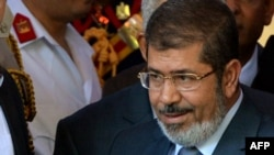 Muhammad Morsi becomes Egypt's fifth president since the overthrow of the monarchy some 60 years ago.