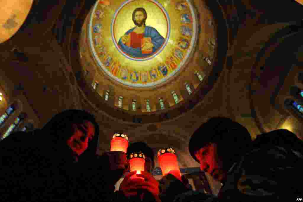 Children hold candles in Saint Mkrtich (Saint John) church in the Armenian city of Abovyan during the Armenian Orthodox Christmas eve. (AFP/Karen Minasyan)