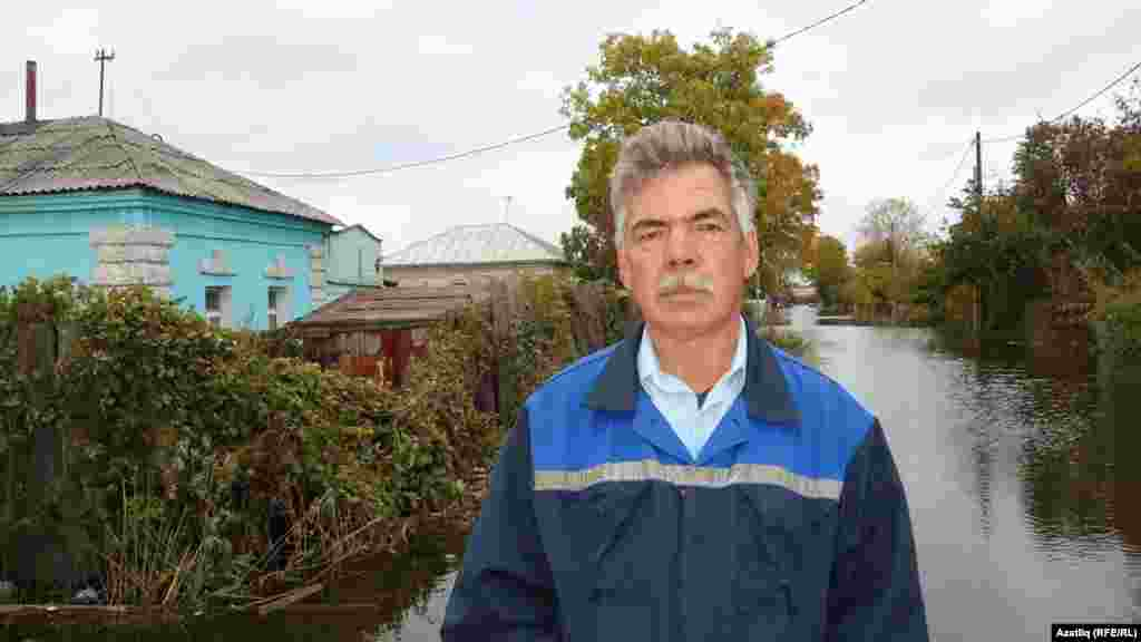 Resident Rafik Fayzullin near his home in Komsomolsk.