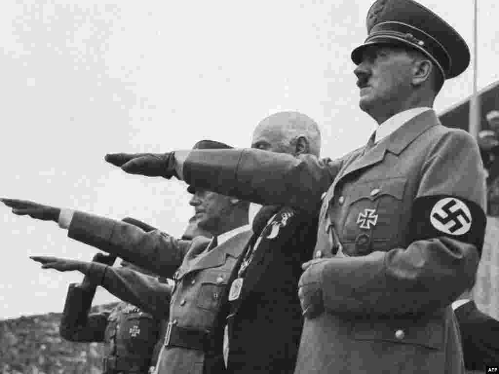 German Chancellor Adolf Hitler gives the Nazi salute during the opening ceremony of the Berlin Olympic Games in 1936.