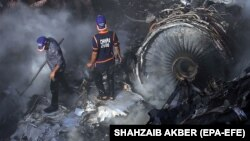 Rescue workers search for survivors amid the wreckage of a passenger plane, which crashed in Karachi on May 22.