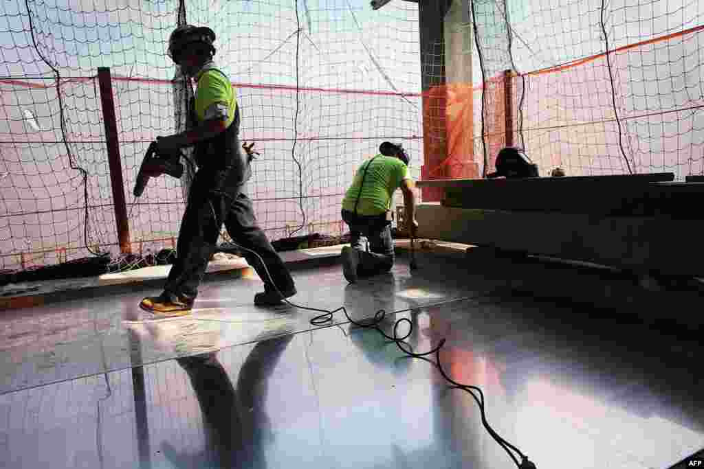 Construction workers work on the 72nd floor at Four World Trade Center on September 7, 2012.