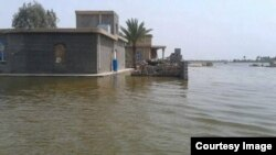 مياه الفرات تغرق قرى زوبع والنعيمية في الأنبار بعد إغلاق سدة الفلوجة.