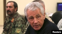 U.S. Defense Secretary Chuck Hagel met with Afghan military leaders in Kandahar on December 8.