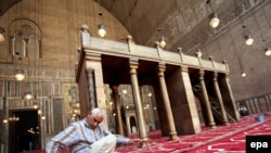 A worker prepares the inside of Cairo's 14th-century Sultan Hassan Mosque, which U.S. President Barack Obama will visit on the Egyptian leg of his trip on June 4.