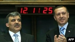 Then-Prime Minister Recep Tayyip Erdogan (right) announces that Abdullah Gul (left) would be the AKP party's candidate for president in Ankara in April 2007.