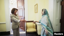 Malala Yousafzai walks to shake hands with U.S. House Minority leader Nancy Pelosi (D-CA) during a visit at Capitol Hill in Washington on June 23.