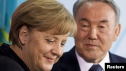 German Chancellor Angela Merkel and Kazakh President Nursultan Nazarbaev at a news conference after talks at the Chancellery in Berlin on February 8