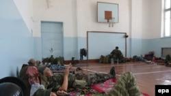 Kyrgyz police were deployed in a school in Osh on June 21.