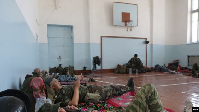 Kyrgyz police were deployed in a school in Osh on June 21.
