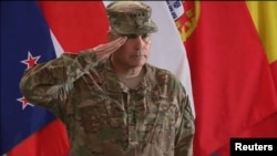 NATO/ISAF Ceremony in Kabul marks the end of combat missions.