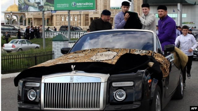 Chechen leader Ramzan Kadyrov (right) escorts the Prophet Muhammad's purported chalice and carpets from the airport to Grozny's central mosque in September.