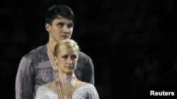 Российские фигуристы Татьяна Волосожар и Максим Траньков