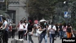Armenia -- People walk in the center of Yerevan, June 10, 2020.